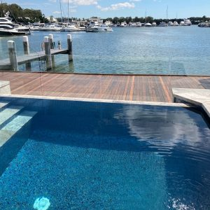 Luxury waterfront swimming pool - Sabrene Glass Mosaic- Loch Ness Blend