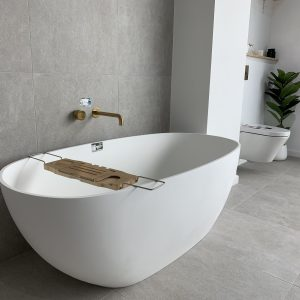 Highgrove Bathrooms - Display - White Bath and Moon Stone Grey Tiles