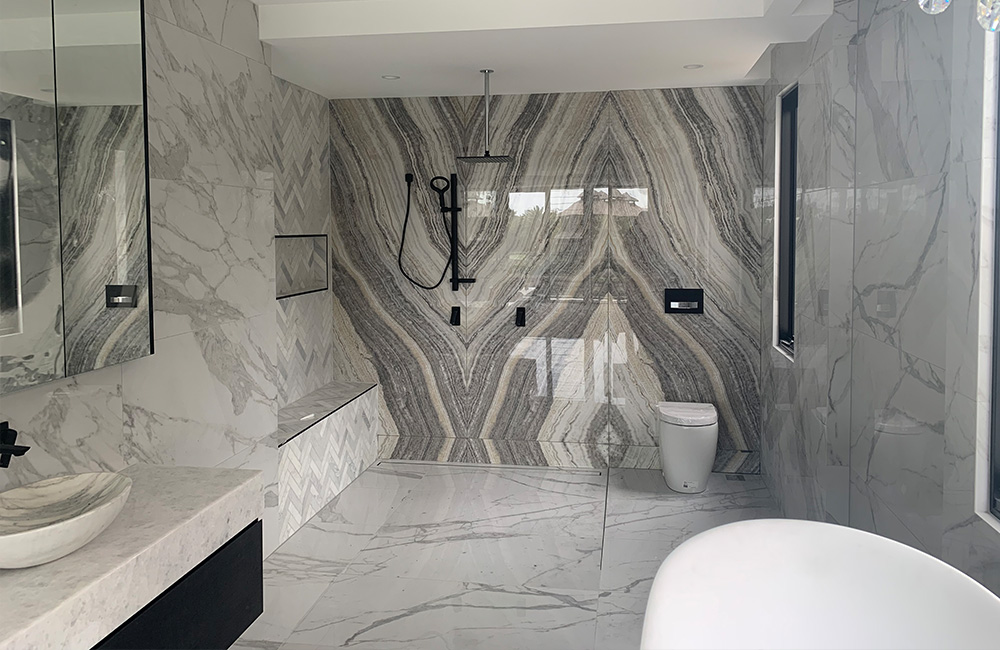 bathroom tiles - marmoker arabesque and statuario marble look porcelain slabs